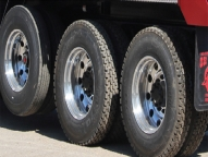 Steel & Aluminum wheels in various sizes and multiple tire configurations on Ox installed lift axles.