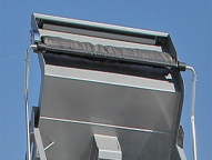 Manual or electric flip or side roll tarps in mesh or vinyl