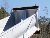 Semi-auto or electric flip tarps, cable systems, or side roll tarps with choice of mesh or vinyl covers.